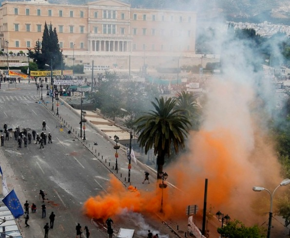 Protesters clash with riot infront of the Greek Parliament in central Athens Wednesday, June 29, 2011. Greek deputies are to vote Wednesday on a deeply unpopular austerity bill that has provoked days of rioting in the streets of Athens, with the result of the vote determining is Greece can avoid a potentially disastrous financial default in the coming weeks .(AP Photo/Petros Giannakouris)