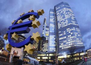 FILE - In this Dec. 16, 2011 file photo the Euro sculpture stands in front of the European Central Bank, right,  in Frankfurt, Germany. The European Central Bank says Monday, Feb. 27, 2012, the amount lent to businesses by banks leveled off in January after a steep plunge in December. The data highlight concerns that companies are still finding credit scarce as the eurozone debt crisis puts pressure on banks. (AP Photo/Michael Probst, File)